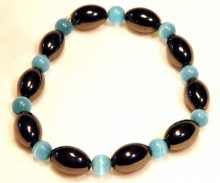 Magnetic Bracelet Blue Cats eye and Olive beads repeated.