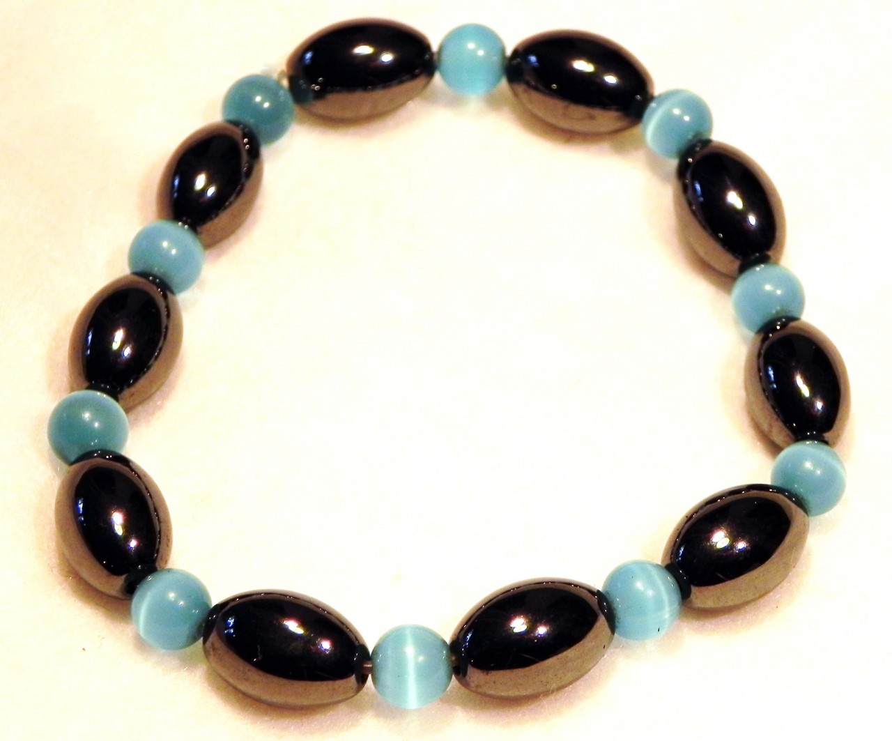magnetic bracelet blue cats eye and olive bead repeat