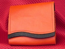 Essential Oil Wallet Orange Leather with Black Trim Available in XSmall and Small XSmall = 3 x 5ml bottles or 3 Rollon Bottles (Bottle Sox needed to convert the loop size) Small = 3 x 15 ml Bottles